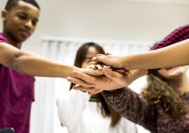 Study group classmates joining hands together teamwork concept